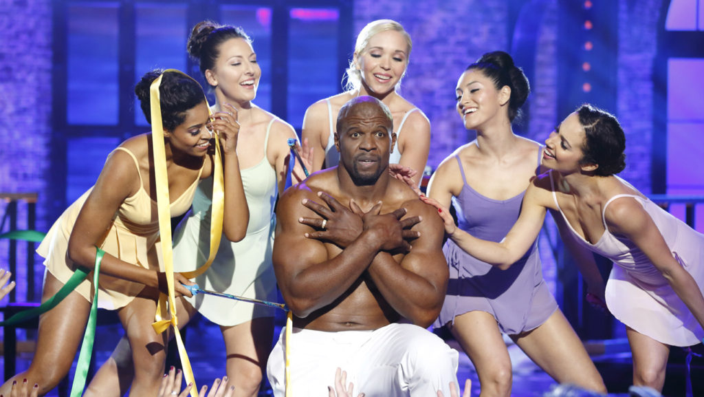 "Terry Crews accessing his ""feminine side"" during his performance of Vanessa Carlton's ""A Thousand Miles."""
