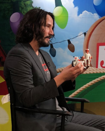 Photo of Keanu holding a Duke Caboom figurine