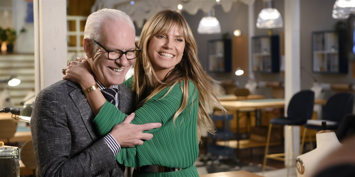 Heidi Klum kissing Tim Gunn