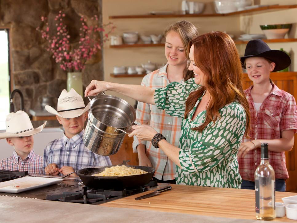 Pioneer Woman Ree Drummond serves food for her family