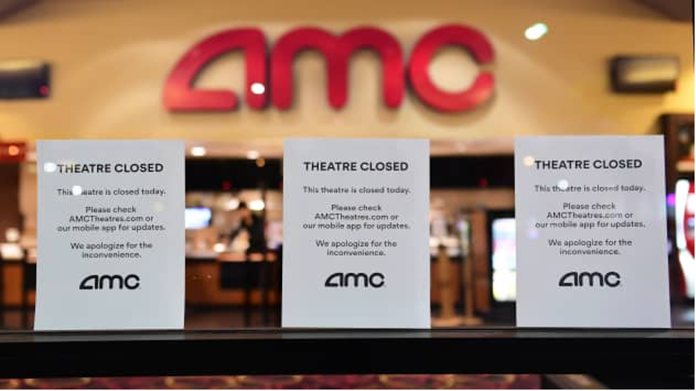 """Theatre Closed"" signs outside an AMC location amid the COVD-19 pandemic"